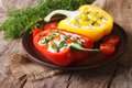 Fresh peppers filled with curd and dill close-up horizontal Royalty Free Stock Photo