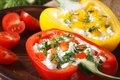 Fresh peppers filled with curd and dill close-up horizontal, rus Royalty Free Stock Photo