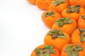 Fresh persimmon fruit food background Royalty Free Stock Photography