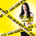 Fresh photo of a crime scene with undead female victim still walking while being tied up with yellow tape Stock Photography