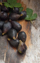 Fresh picked figs on a wooden table Stock Photography