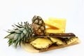 Fresh Pineapple Pieces And Knife On A Cutting Boar Royalty Free Stock Image