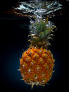 Fresh pineapple in water Royalty Free Stock Images