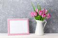 Fresh pink tulip flowers and photo frame