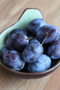 Fresh plums in a bowl Stock Images