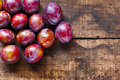Fresh plums on old table Royalty Free Stock Image