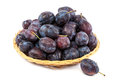 Fresh plums in a wicker dish Royalty Free Stock Photo