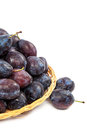 Fresh plums in a wicker dish. Royalty Free Stock Photo