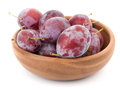 Fresh plums in a wooden bowl Royalty Free Stock Photo