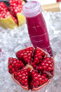 Fresh pomegranate on ice with juice Stock Photography