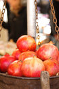 Fresh pomegranates in a metal basket Royalty Free Stock Photo