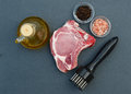 Fresh pork meat and tenderizer Royalty Free Stock Photo