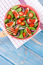 Fresh prepared fruit and vegetable salad with fork, concept of healthy lifestyle, food and nutrition Royalty Free Stock Photo
