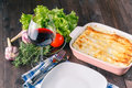 Fresh prepared lasagne with ingredients on table Royalty Free Stock Photo