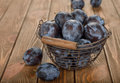 Fresh prunes in a basket on a brown background Stock Image