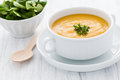 Fresh pumpkin cream soup and salad Stock Image