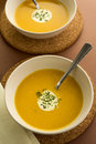 Fresh pumpkin soup with cream garnish hot and parsley served in round ceramic bowls Royalty Free Stock Images