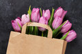 Fresh purple tulip flowers bag Royalty Free Stock Photo