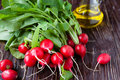 Fresh radish with leaves on the boardsâ and cooking oil food Royalty Free Stock Photography