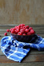 Fresh raspberries in a bowl on the table food close up Stock Images