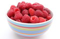 Fresh raspberries with a bowl on a white background in isolated Stock Images