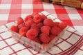 Fresh raspberries rasberries in the store container Royalty Free Stock Photos