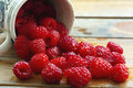 Fresh raspberries red on a wooden table Royalty Free Stock Photos