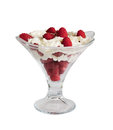 Fresh raspberries  with whipped cream in glass bowl isolated Royalty Free Stock Photo