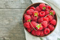 Fresh raspberries in wooden bowl Royalty Free Stock Photo