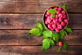 Fresh raspberry with leaves Royalty Free Stock Photo