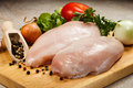 Fresh raw chicken breasts on cutting board Stock Image
