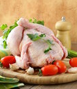 Fresh raw chicken cutting board vegetables herbs Royalty Free Stock Photography
