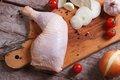 Fresh raw chicken leg on a cutting board top view Stock Images