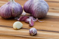 Fresh raw garlic close up of garden on a wooden cutting board Royalty Free Stock Images