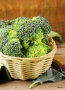 Fresh raw green cabbage broccoli in a wicker basket Stock Images