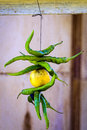 Fresh Raw Green Chillis and Lemon Royalty Free Stock Photo
