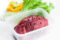Fresh raw meat and vegetables white background Stock Photo