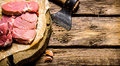 Fresh raw minced meat with an axe. Royalty Free Stock Photo