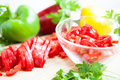 Fresh raw peppers sliced ​​and whole Stock Photo