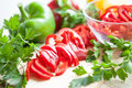 Fresh raw peppers sliced ​​and whole. Stock Photography