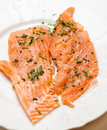 Fresh raw salmon chunks with herbs Royalty Free Stock Images