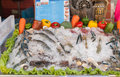 Fresh raw sea foods and fish at cooking table in domestic Stock Photos