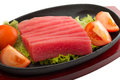 Fresh raw tuna fish pieces on plate isolated Royalty Free Stock Photo