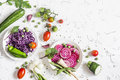 Fresh raw vegetables - red cabbage, beet, zucchini, green beans, tomatoes on a light background. Royalty Free Stock Photo