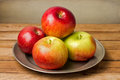 Fresh red apples on plate Stock Photography