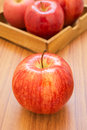 Fresh red apples on wooden background Royalty Free Stock Images