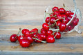 Fresh red cherries in glass bowl against on a wooden table Royalty Free Stock Photo
