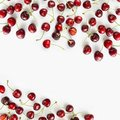 Fresh red cherries lay on white isolated background with copy space for text. Background of cherries. Ripe cherry on a white backg Royalty Free Stock Photo