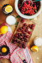 Fresh red cherries on a rustic  wooden table.  Ripe cherries i o Royalty Free Stock Photo