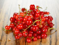 Fresh red currants on a brown table Stock Photo